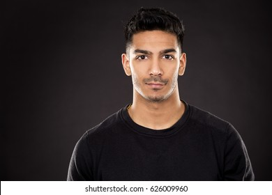young fit indian man wearing dark workout outfit