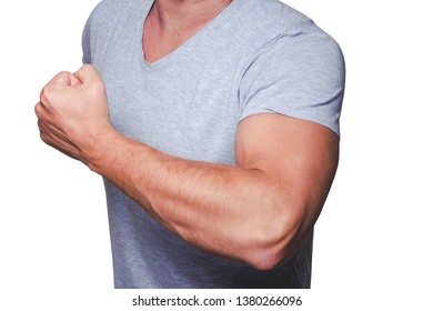 Young fit male model showing his biceps isolated on white.