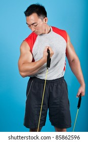 Young fit man with exercise stretch band