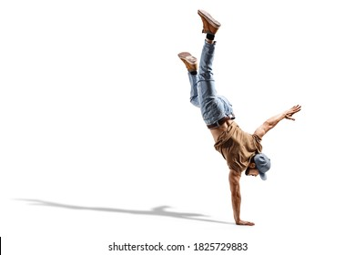 Young fit man in jeans performing a one hand stand isolated on white background