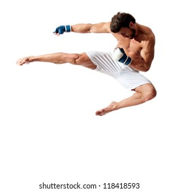 young fit man jumping, high kick and fist punch, muay thai equipment