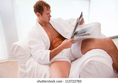 Young Fit Man Reading Morning Paper