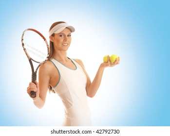 Young fit sexy female tennis player over blue background