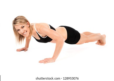 Young fit woman doing push-ups isolated on white