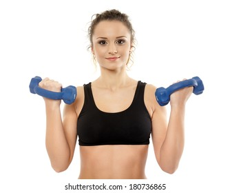 Young fit woman with dumbbells working out, isolated on white background