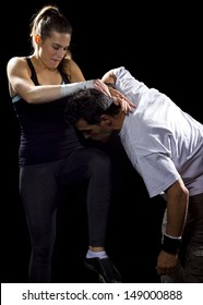 young fit woman fighting a man. battle of the sexes.