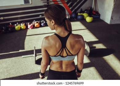 Young fit woman at gym.