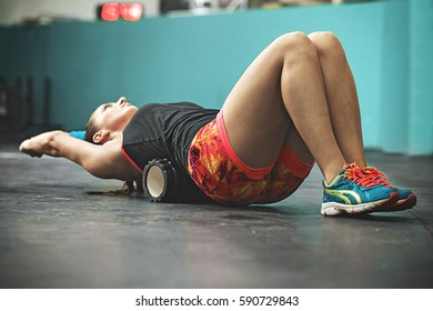 Young fit woman preparing body for training.