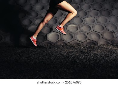 Young fit woman running fast. Close-up