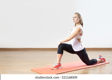 Young fit woman works out in the fitness class.