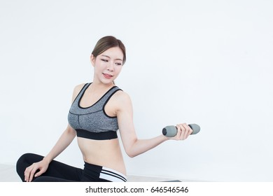 Young Fitness Asian girl lifting dumbbell, workout in bedroom, fitness, training and lifestyle concept