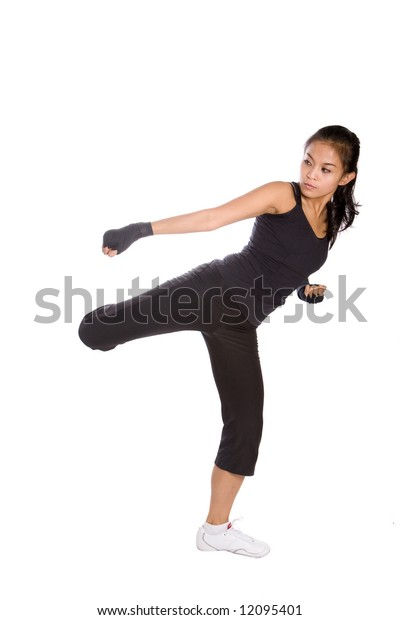 Young fitness female in combat stance as part of healthy lifestyle concept