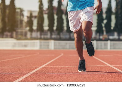 young fitness man runner athlete running at stadium
