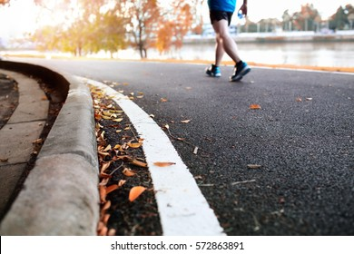 Young fitness man runner athlete walking in the park.