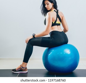 Young fitness woman with blue fitball. Crossfit training. Fitness concept.