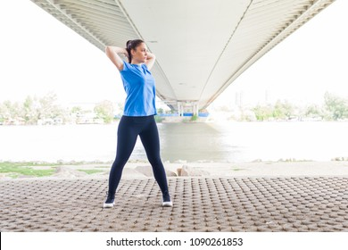 Young Fitness Woman doing workout outdoor, stretching exercise