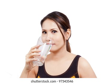 young fitness woman drinking a fresh water