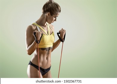 young fitness woman execute exercise on green background, horizontal photo portrait