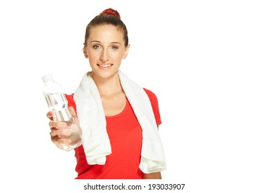 Young fitness woman giving bottle of water