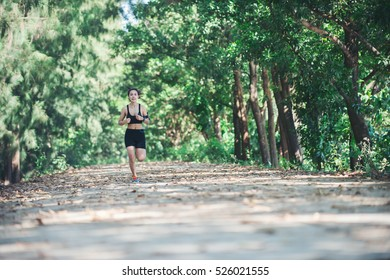Young fitness woman jogging in park.