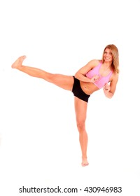 young fitness woman kick with leg isolated on a white background