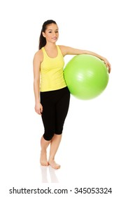 Young fitness woman with pilates ball.