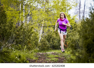 Young Fitness Woman Running Forest Trail