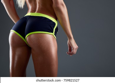 Young fitness woman showing sports ass