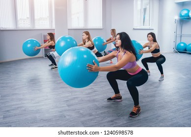 Young fitness women with blue fitballs. Crossfit training. Fitness concept.