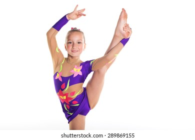 Young and flexible sporting girl stretch her leg up on rhythmic gymnastic championship