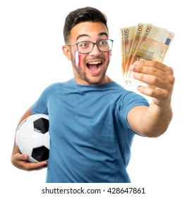 Young football fan holding fifty euro bills