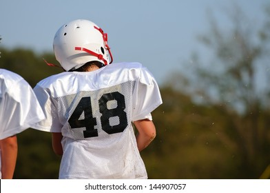 Young football pre-teen from behind