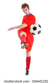 Young footballer or soccer player cut out on a white background