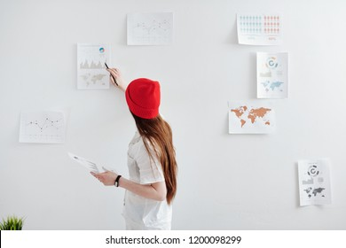 Young freelance designer working on creating infographics - Shutterstock ID 1200098299