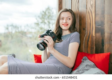 Young freelancer girl is working hard in laptop in loft interior