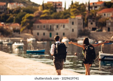 Young freelancing photographers enjoying traveling and backpacking.Photojournalism.Documentary travel photos.Lightweight travel photography gear,backpack and equipment.Low budget traveling experience