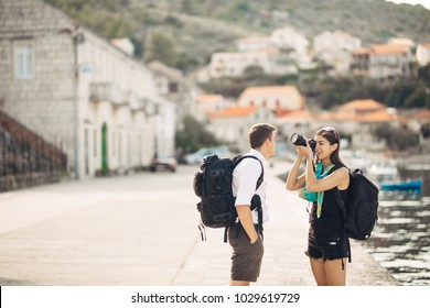 Young freelancing photographers traveling and backpacking.Experiencing different cultures,photojournalism.Documentary travel photos of third world countries.Exotic destinations.Low budget traveling