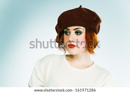 Young French Brunette Girl With Short Haircut In Brown Beret On Light Grey Background Work