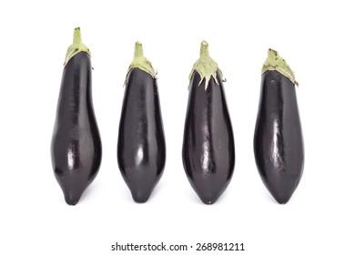 Young fresh black eggplants isolated on white