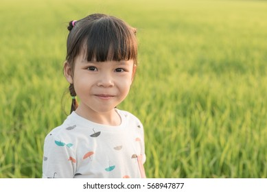 Young fresh girl at wheat field portrait