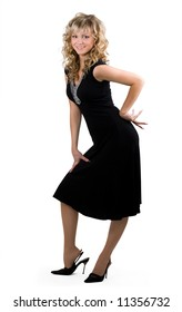 Young friendly blond woman in black dress on isolated background
