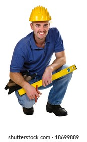 Young friendly crouch manual worker isolated on white
