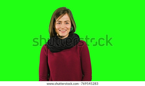 Young Friendly Lady Smiling Nodding Against Stock Photo Edit Now 769545283