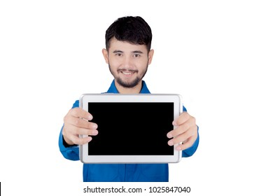 Young friendly mechanic holding digital tablet with copy space over white background