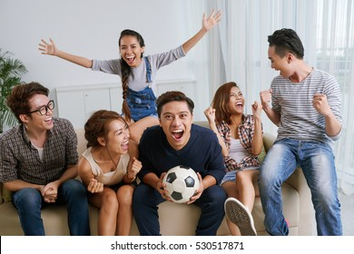 Young friends cheering for soccer team