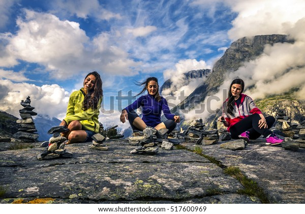 Young friends are collecting stones, Norway