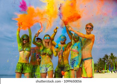 Young friends colored with color powder gulal laughing