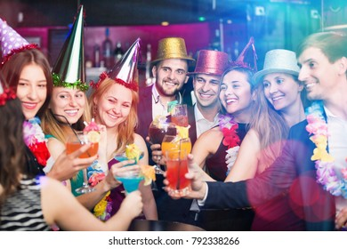 Young friends dancing on birthday party with cocktails