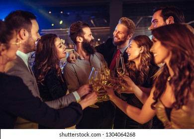 Young friends drinking champagne at a party