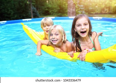 young friends in the garden pool